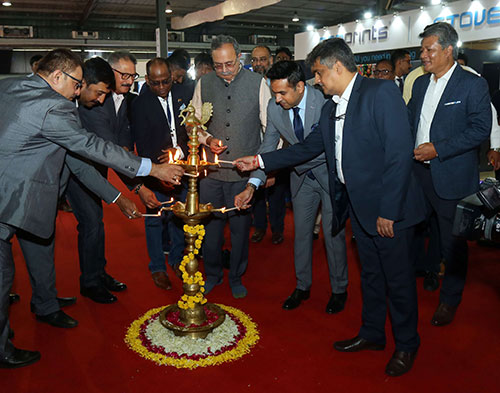 Saurabh Patel Energy Minister Govt. of Gujarat at the Centre along with other dignitaries lightning the lamp at ITMACH inauguration